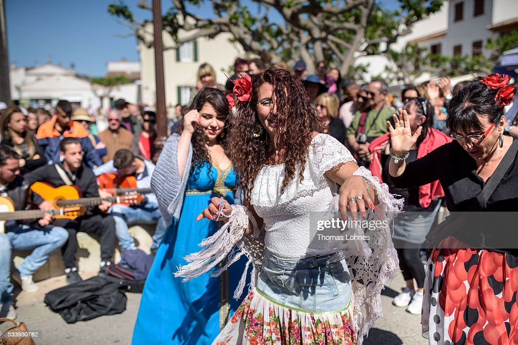 Gypsies dance in front of the church on May 24, 2016 in Staintes Maries de la Mere near Arles, France. Gypsies from all over Europe worship 'Sara the Black', their Saint and patroness, for one week. Sara's statue is situated in the crypt of the church. She wears a multicoloured dress and will carried by the gypsies to the sea at this afternoon.
