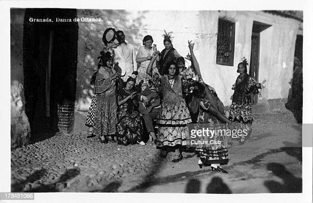 Gypsies dancing Granada Spain Gypsy women dancing while a men play an acoustic guitar and tambourine