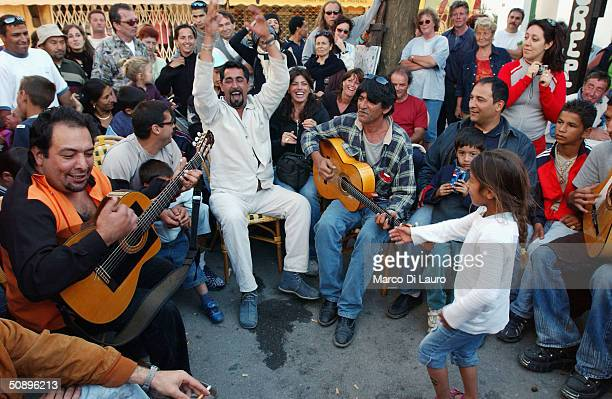 Gypsies enjoy the music in a cafe in Saintes Maries de la Mer in the Camargue region of Southern France on May 25 2004 The annual pilgrimage is...