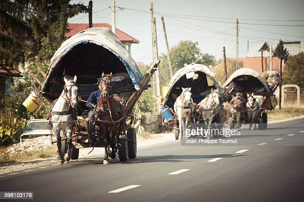 Gypsies on the road with horses and trailers, near Curtea de Arges in Romania, Europe