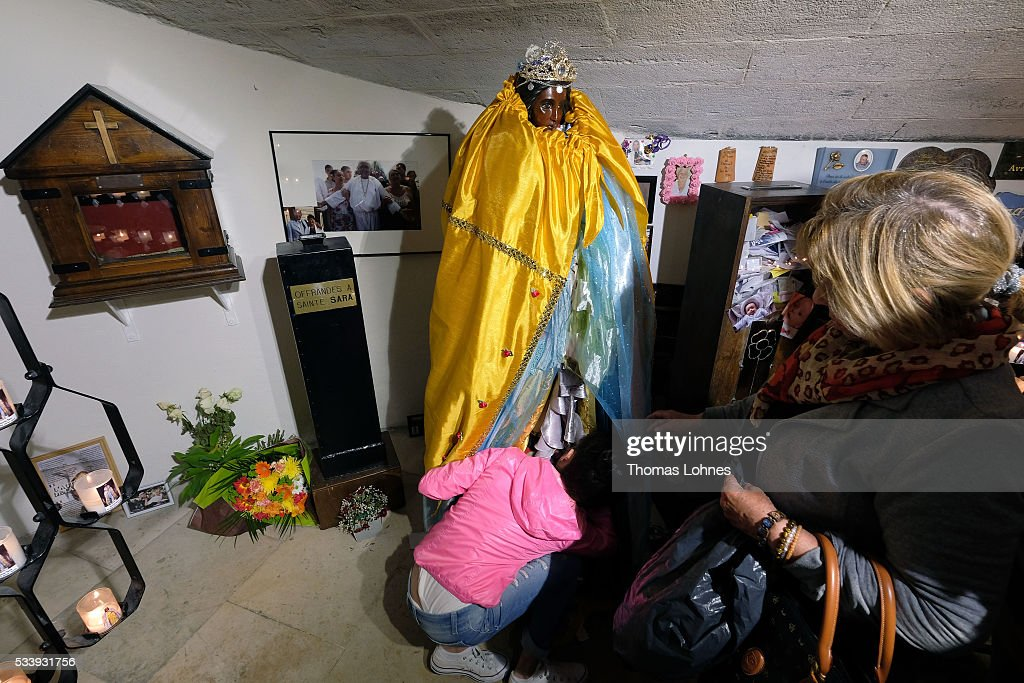 Gypsies worship Sara's statue in the crypt of the church on May 24, 2016 in Staintes Maries de la Mere near Arles, France. Gypsies from all over Europe worship 'Sara the Black', their Saint and patroness, for one week. She wears a multicoloured dress and will carried by the gypsies to the sea at this afternoon.