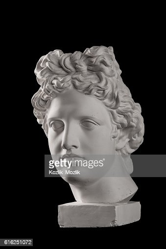 Gypsum statue of Apollo's head on a black background : Stock Photo