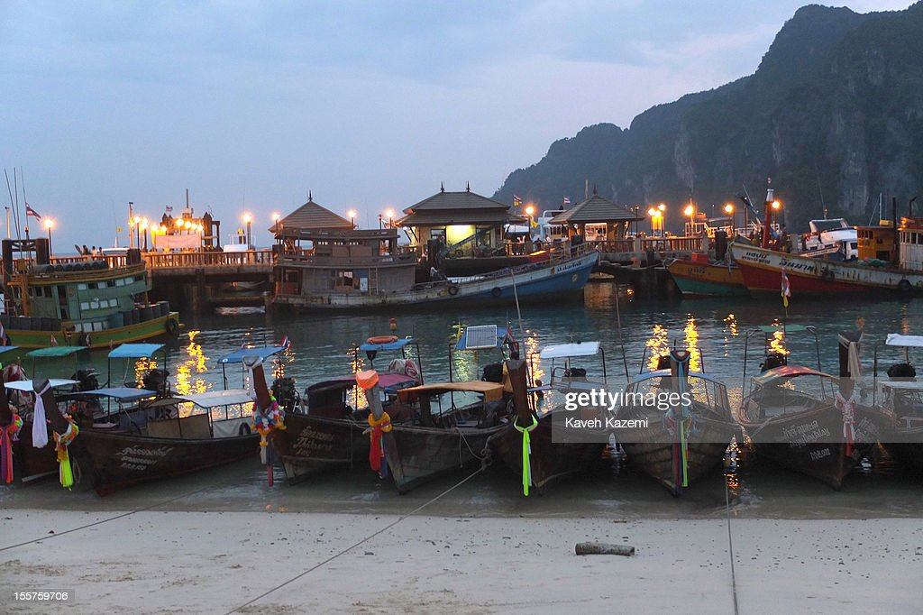Gypsy boats seen anchored near the ferry pier at night on October 20 in Koh Phi Phi Don, Thailand.