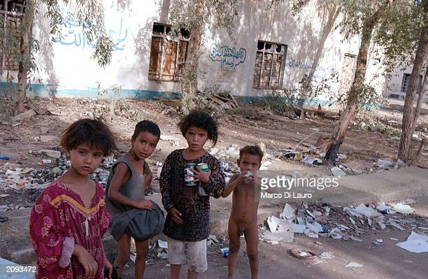 Gypsy children play in the street in front of their house as they collect aluminum cans to sell in a former Iraqi army military compound June 18 2003...