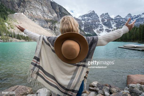 Gypsy girl arms outstretched at Moraine lake