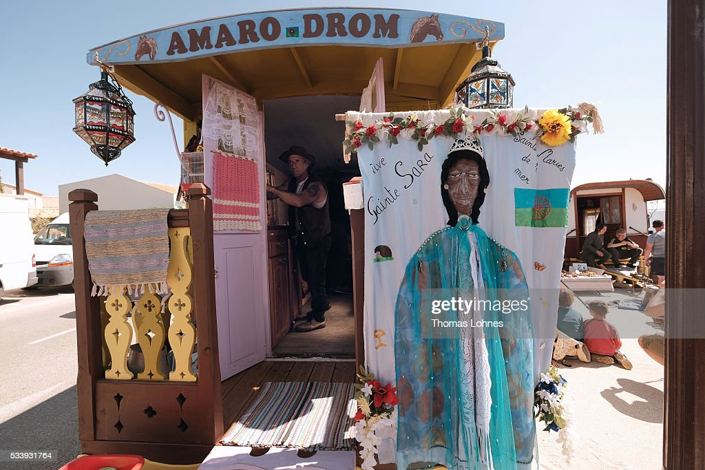 A gypsy is seen in his traditional wagon with a painting of 'Sara the Black' on May 24, 2016 in Staintes Maries de la Mere near Arles, France. Gypsies from all over Europe worship 'Sara the Black', their Saint and patroness, for one week. Sara's statue is situated in the crypt of the church. She wears a multicoloured dress and will carried by the gypsies to the sea at this afternoon.