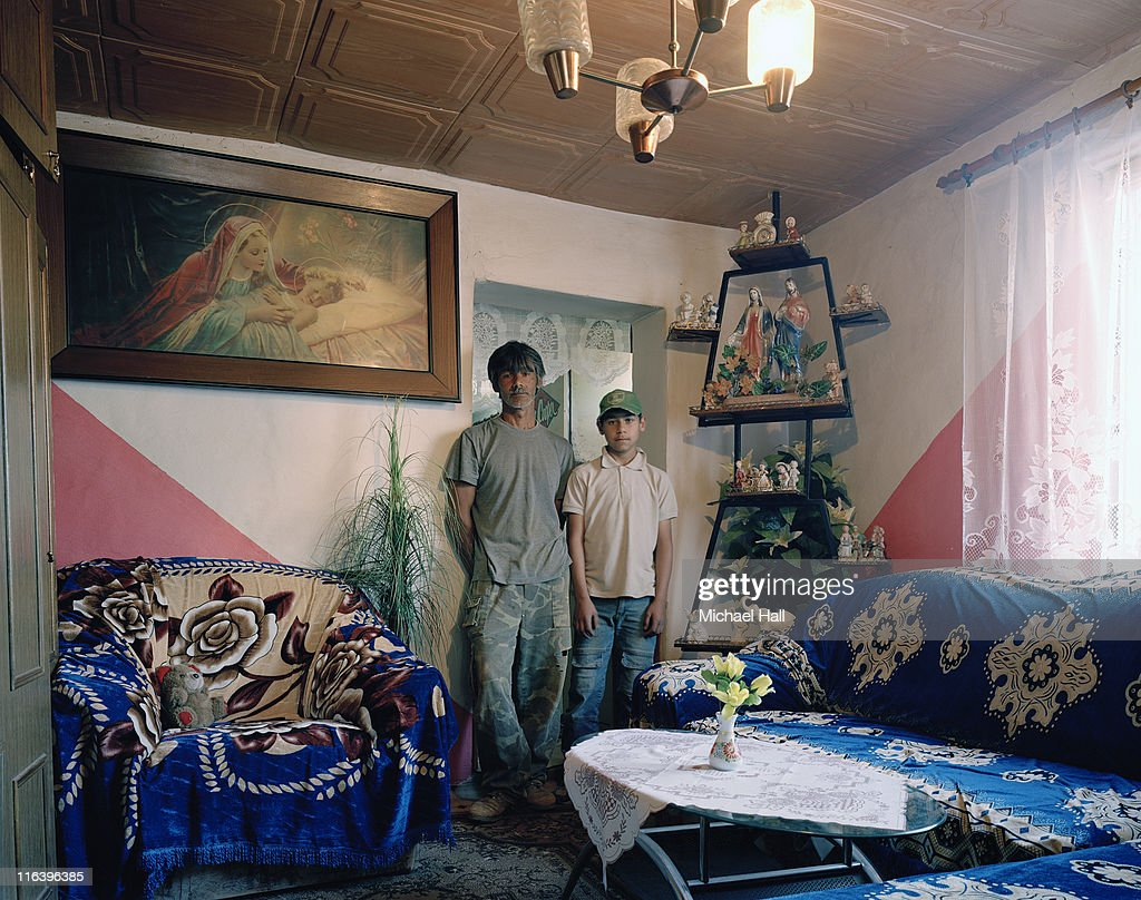 Gypsy man and son at home : Stock Photo