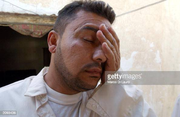 Gypsy man wakes up from a hangover in a former Iraqi army military compound June 18 2003 in the outskirts of Baghdad About 135 Gypsy families are...