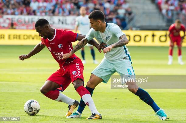 Gyrano Kerk of FC Utrecht Leandro Paredes of FK Zenit St Petersburg during the UEFA Europa League fourth round qualifying first leg match between FC...