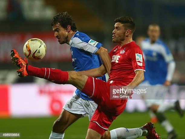 György Garics of Darmstadt is challenged by Jonas Hector of Koeln during the Bundesliga match between SV Darmstadt 98 and 1 FC Koeln at MerckStadion...