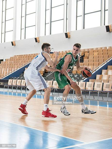 Gytis Masiulis #21 of U18 Zalgiris Kaunas competes with Ivan Fevrier #13 of U18 U18 Insep Paris during the Turkish Airlines Euroleague Basketball...