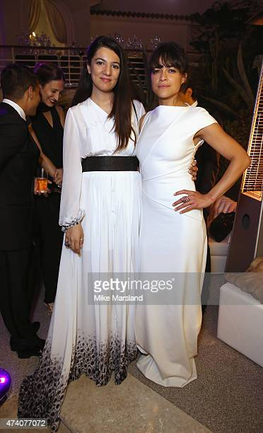 Gyunel Rustamova and Michelle Rodriguez attend the De Grisogono Divine In Cannes Dinner Party at Hotel du CapEdenRoc on May 19 2015 in Cap d'Antibes...