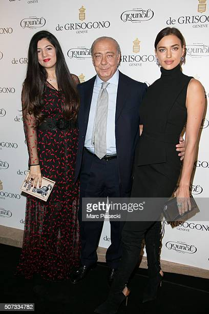 Gyunel Rustamova Fawaz Grusoi and Irina Shayk attend the 'De Grisogono' La Boetie cocktail on January 28 2016 in Paris France