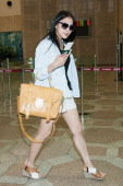Gyuri of South Korean girl group Kara is seen on departure at Gimpo International Airport on June 1 2013 in Seoul South Korea