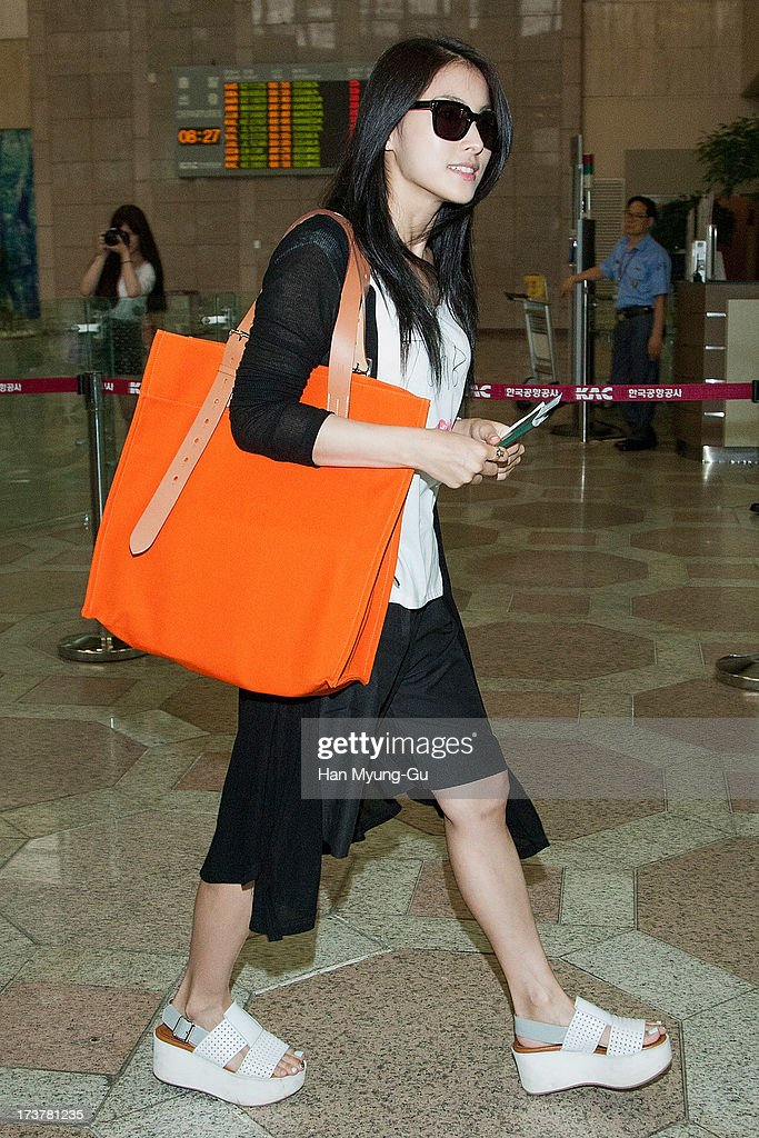 Gyuri of South Korean girl group Kara is seen on departure at Gimpo International Airport on July 18, 2013 in Seoul, South Korea.