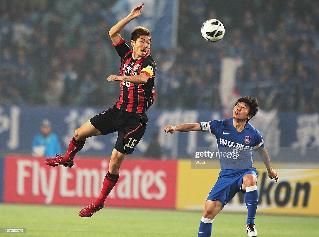 Ha Dae-Sung #16 of FC Seoul jumps to head the ball during the AFC Champions League match between Jiangsu Sainty and FC Seoul at Nanjing Olympic Sports Center Stadium on April 24, 2013 in Nanjing, China.