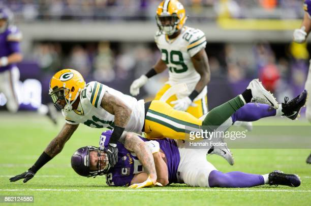 Ha Ha ClintonDix of the Green Bay Packers tackles Kyle Rudolph of the Minnesota Vikings after a reception during the game on October 15 2017 at US...
