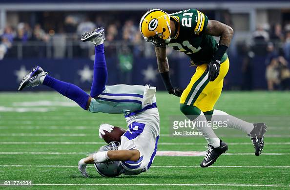 Ha Ha ClintonDix of the Green Bay Packers tackles Terrance Williams of the Dallas Cowboys in the second half during the NFC Divisional Playoff Game...