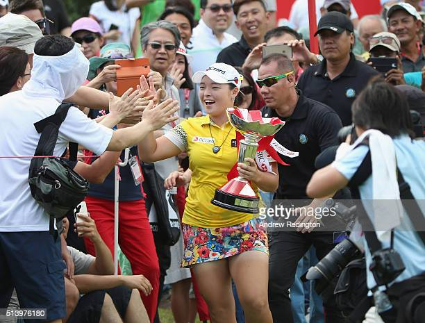 Ha Na Jang of South Korea celebrates with the crowd after winning the HSBC Women's Champions at Sentosa Golf Club on March 6 2016 in Singapore...