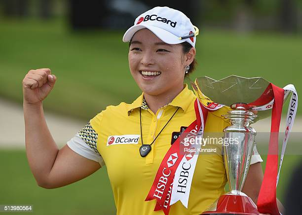 Ha Na Jang of South Korea celebrates with the winners trophy after the final round of HSBC Women's Champions at the Sentosa Golf Club on March 6 2016...
