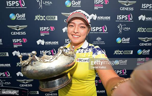 Ha Na Jang of South Korea imitates taking a selfie photo with her trophy after winning the Women's Australian Open during round four of the ISPS...