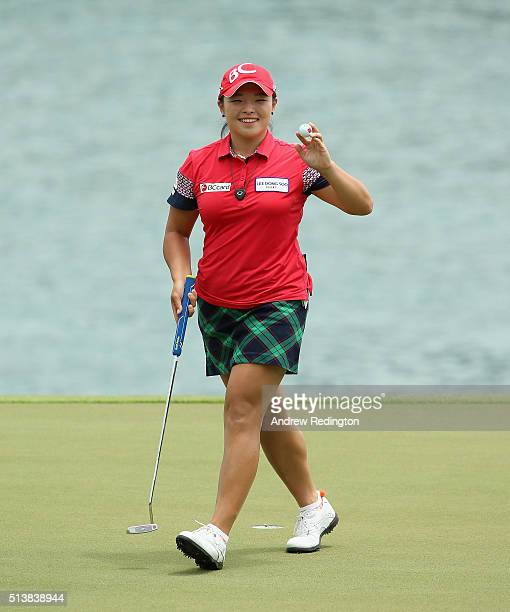 Ha Na Jang of South Korea waves to the crowd after her birdie on the seventh hole during the third round of the HSBC Women's Champions at Sentosa...