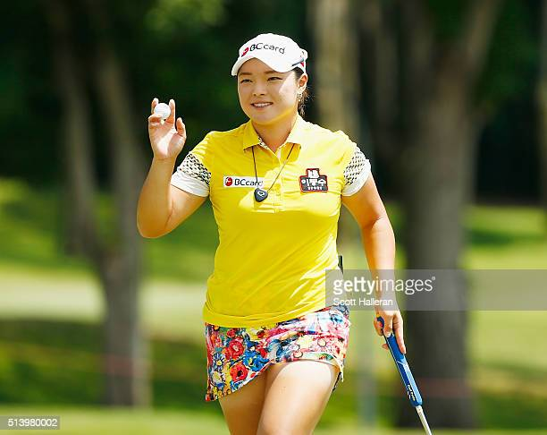 Ha Na Jang of South Korea waves to the gallery on the 16th green during the final round of the HSBC Women's Champions at Sentosa Golf Club on March 6...