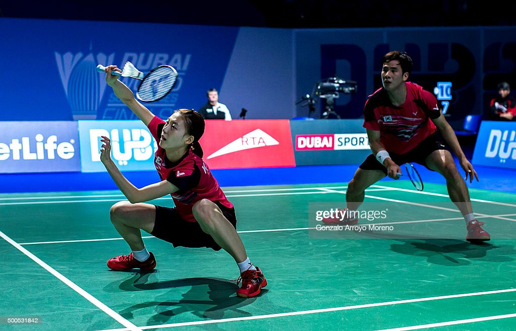Ha Na Kim (L) and Sung Hyun Ko of Korea in action in the mixed doubles match agianst Joachim Fischer Nielsen and Christinna Pedersen of Denmark during day one of the BWF Dubai World Superseries 2015 Finals at the Hamdan Sports Complex on on December 9, 2015 in Dubai, United Arab Emirates.