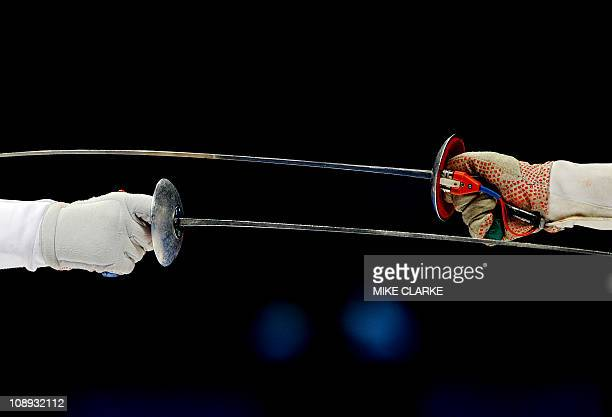 OH Ha Na of South Korea competes against Lin Po Heung of Hong Kong during the Women's Team Foil semifinals of the fencing at the 16th Asian Games in...