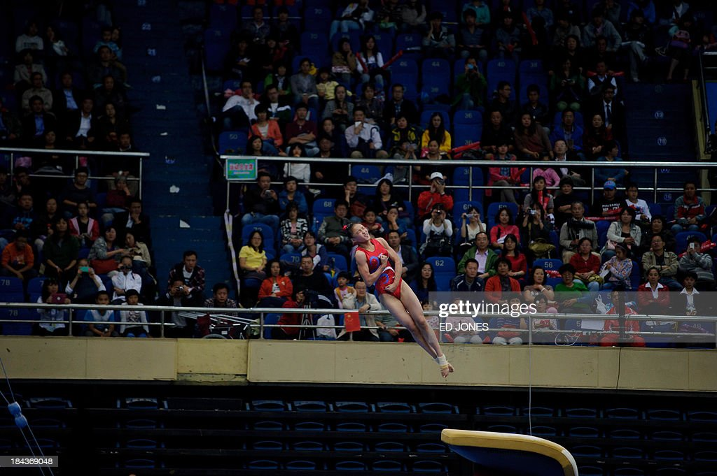 Ha Ri Un of North Korea competes during the Women's Vault final gymnastics event of the 6th East Asian Games in Tianjin on October 13, 2013. The eastern Chinese city is hosting the East Asian Games which sees nine countries participating in 262 events across 22 different sports. AFP PHOTO / Ed Jones