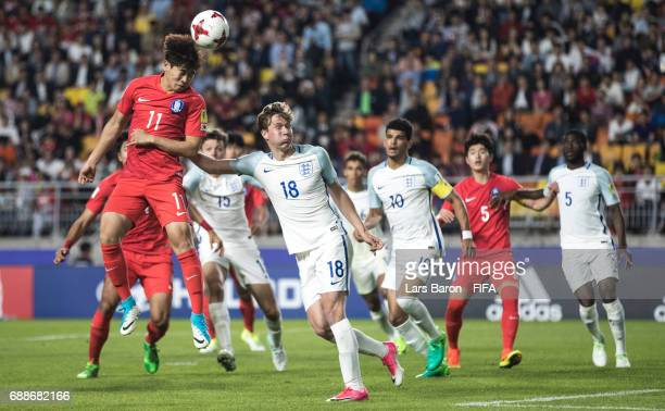 Ha Seungun of Korea Republic goes up for a header next to Kieran Dowell of England during the FIFA U20 World Cup Korea Republic 2017 group A match...