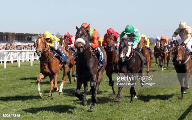 Haaf A Sixpence ridden by Andrea Atzeni on their way to victory in Berry Bros Rudd Magnum Spring Cup during the New To Racing Spring Trials Raceday...