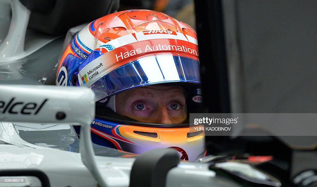 Haas F1 Team's French driver Romain Grosjean sits in his car during the third practice session of the Formula One Russian Grand Prix at the Sochi Autodrom circuit on April 30, 2016. / AFP / YURI