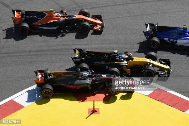 TOPSHOT Haas F1's French driver Romain Grosjean and Renault's British driver Jolyon Palmer compete in the Formula One Russian Grand Prix at the Sochi...