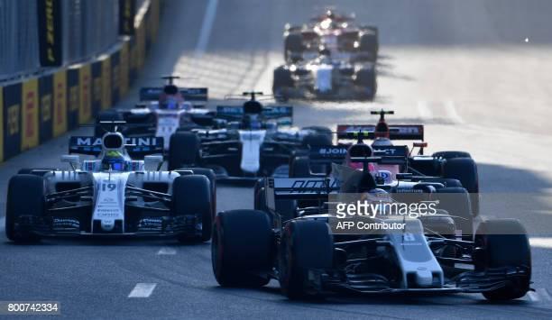 Haas F1's French driver Romain Grosjean and Williams' Brazilian driver Felipe Massa steer their cars during the Formula One Azerbaijan Grand Prix at...