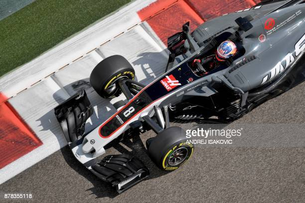 Haas F1's French driver Romain Grosjean drives during the first practice session ahead of the Abu Dhabi Formula One Grand Prix at the Yas Marina...