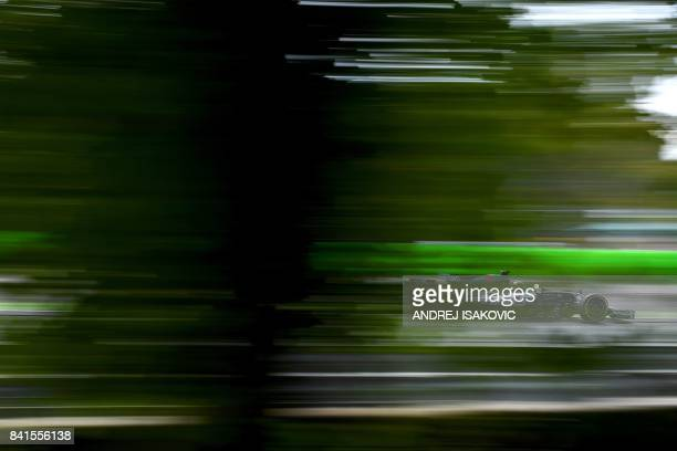 TOPSHOT Haas F1's French driver Romain Grosjean drives during the second practice session at the Autodromo Nazionale circuit in Monza on September 1...