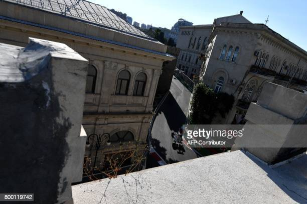 Haas F1's French driver Romain Grosjean steers his car during the second practice session of the Formula One Azerbaijan Grand Prix at the Baku City...