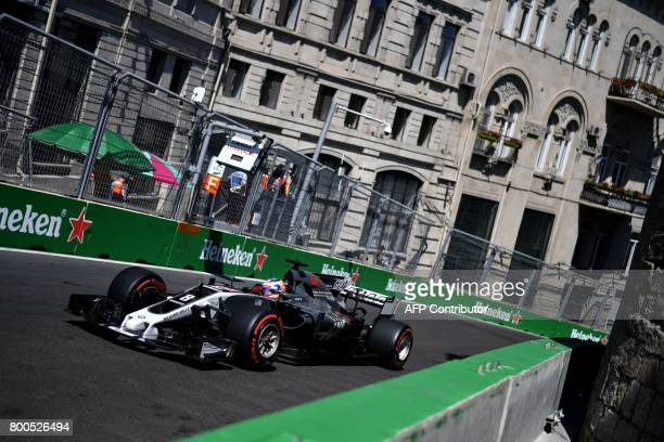 Haas F1's French driver Romain Grosjean steers his car during the third practice session of the Formula One Azerbaijan Grand Prix at the Baku City...