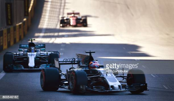 Haas F1's French driver Romain Grosjean steers his car during the qualifying session for the Formula One Azerbaijan Grand Prix at the Baku City...
