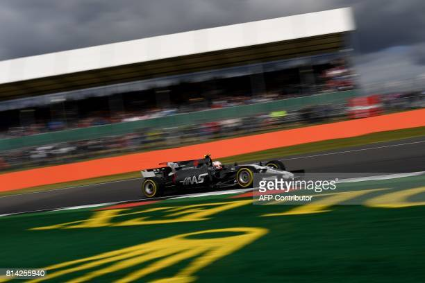 CORRECTION Haas F1's Italian driver Antonio Giovinazzi drives during the first practice session at the Silverstone motor racing circuit in...
