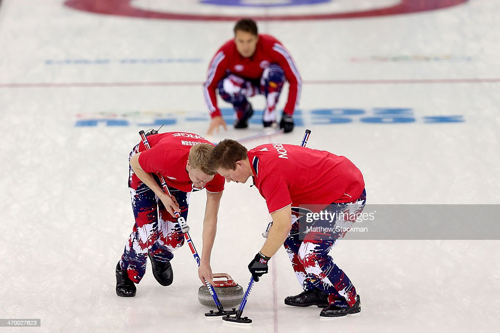 Haavard Vad Petersson and Christoffer Svae of Norway sweep the ice while playing Great Britain during the Curling at Ice Cube Curling Center on day 11 of the 2014 Sochi Winter Olympics on February 18, 2014 in Sochi, Russia.