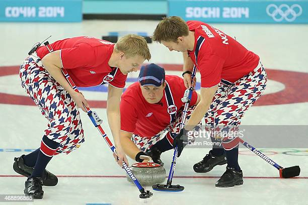 Haavard Vad Petersson Christoffer Svae and Torger Nergaard of Norway compete in the Curling Men's Round Robin match between Norway and Germany during...