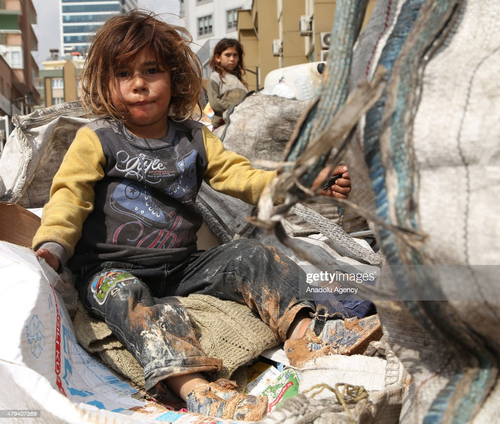 Habes Halil escaped Syrian civil war from Aleppo tries to live on collecting scrap with his two children in Gaziantep Turkey on March 18 2014 Stating...