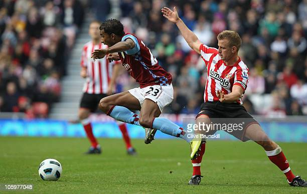 Habib Baye of Aston Villa leaps over a challenge from Lee Cattermole of Sunderland during the Barclays Premier League match between Sunderland and...