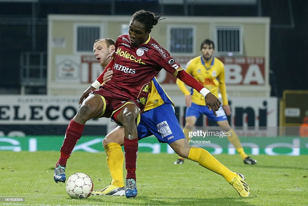 Habib Habibou of Zulte Waregem and Jorn Vermeulen of Waasland Beveren during the Jupiler Pro League match between Zulte Waregem and Waasland Beveren on November 10, 2013 in Waregem, Belgium.