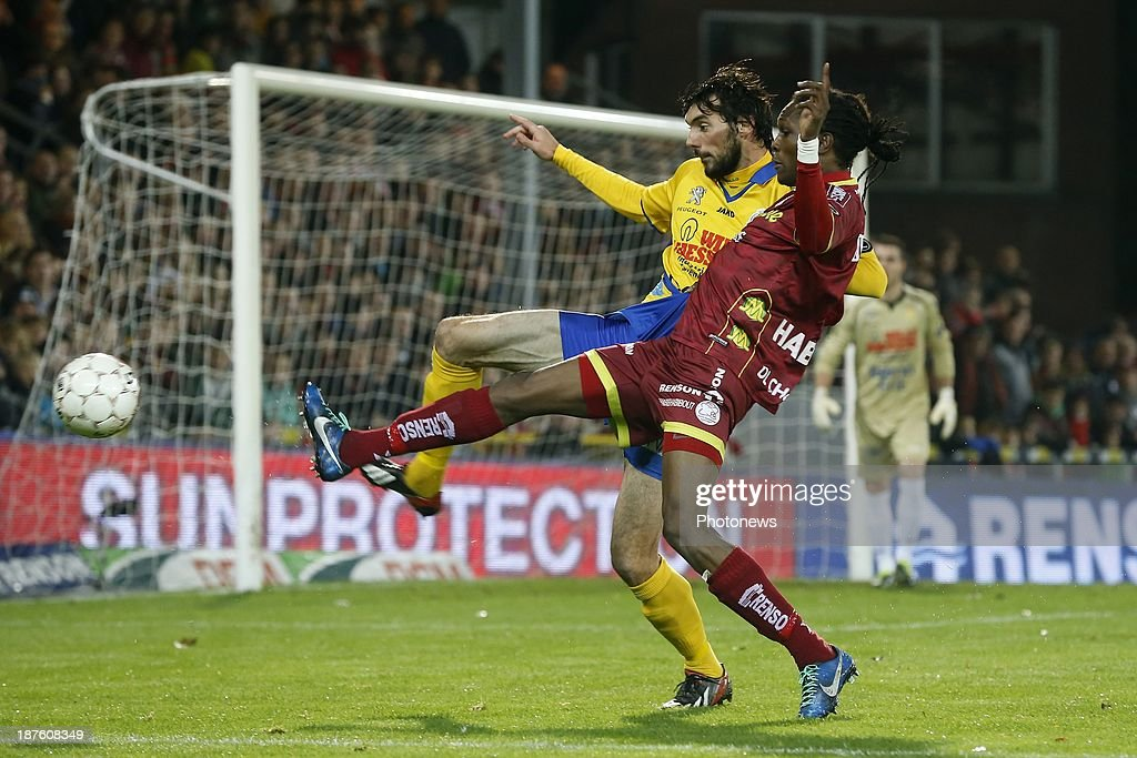Habib Habibou of Zulte Waregem and Mijusko Bojovic of Waasland Beveren during the Jupiler Pro League match between Zulte Waregem and Waasland Beveren on November 10, 2013 in Waregem, Belgium.