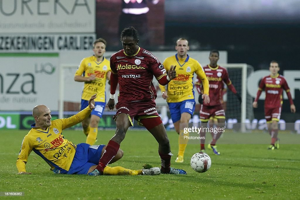 Habib Habibou of Zulte Waregem and Milos Maric of Waasland Beveren during the Jupiler Pro League match between Zulte Waregem and Waasland Beveren on November 10, 2013 in Waregem, Belgium.