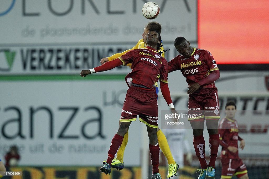 Habib Habibou of Zulte Waregem, Junior Malanda of Zulte Waregem and Dalibor Veselinovic of Waasland Beveren during the Jupiler Pro League match between Zulte Waregem and Waasland Beveren on November 10, 2013 in Waregem, Belgium.