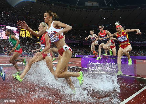 Habiba Ghribi of Tunisia and Marta Dominguez of Spain compete in the Women's 3000m Steeplechase final on Day 10 of the London 2012 Olympic Games at...